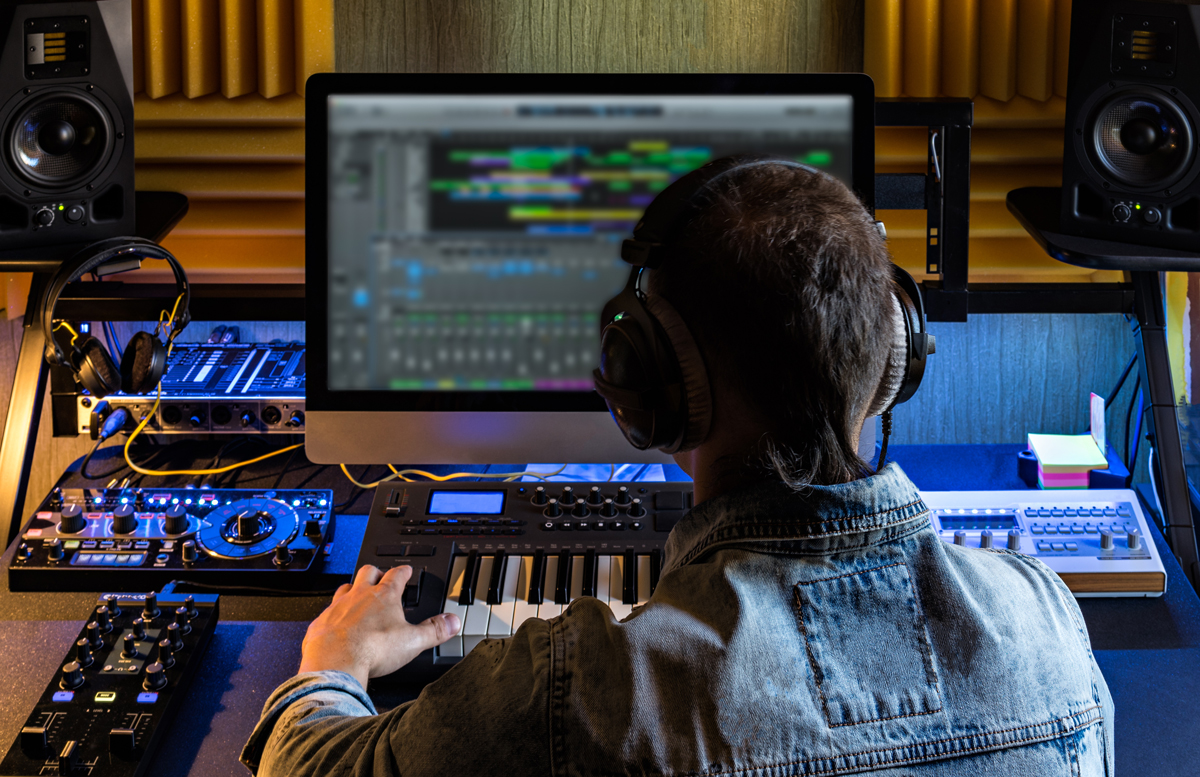 A technician edits audio on an editing station