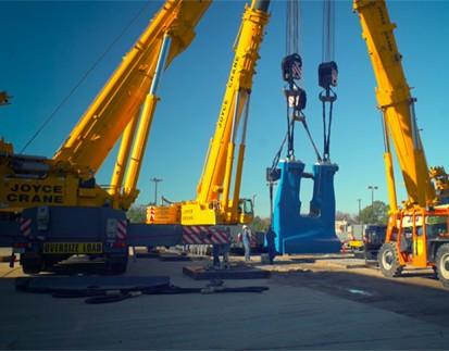 Three crane lift