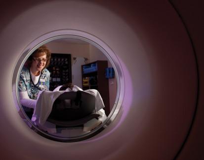 Nurse giving patient MRI