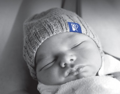 baby with good shepherd logo on beanie